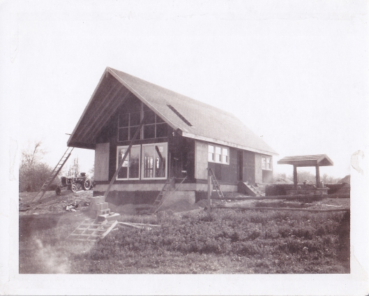 Aunt Georgia's house in the process of construction.  To the right is a covered pump that was already on the property.